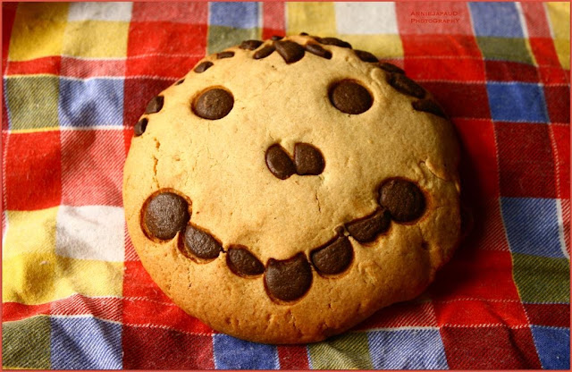 chocolate chip cookie with a smile