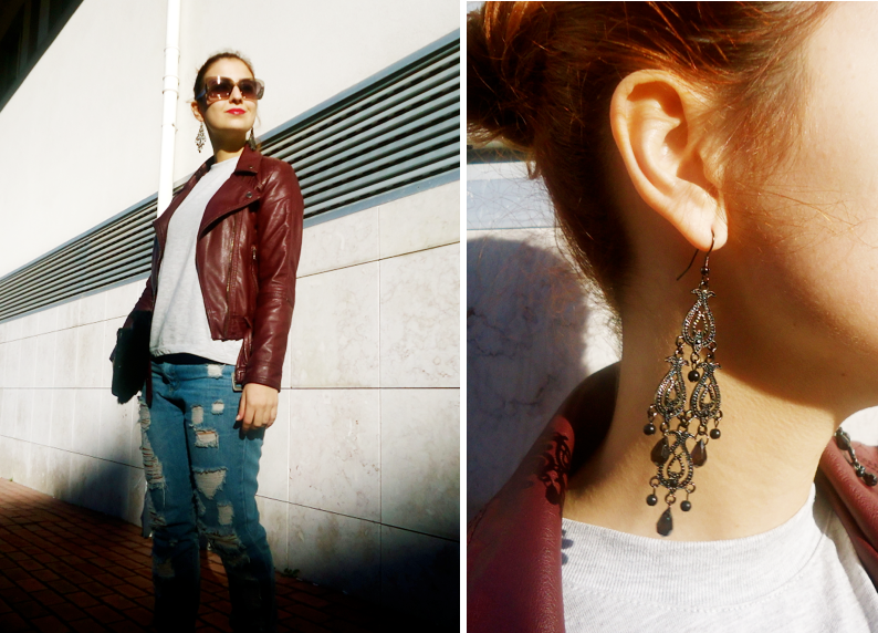 fashion blogger wearing oxblood leather jacket and statement earrings