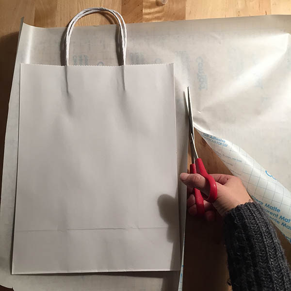 Cutting contact paper to fit a white craft bag