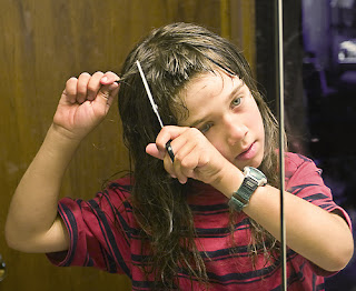 kid cutting hair
