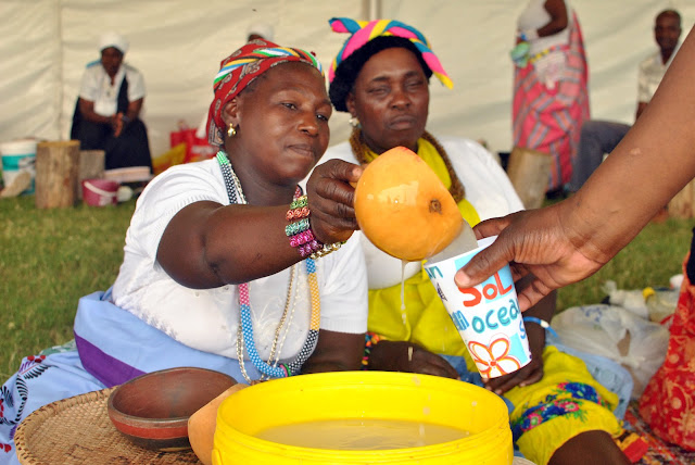 Tsonga woman sharing traditional tea