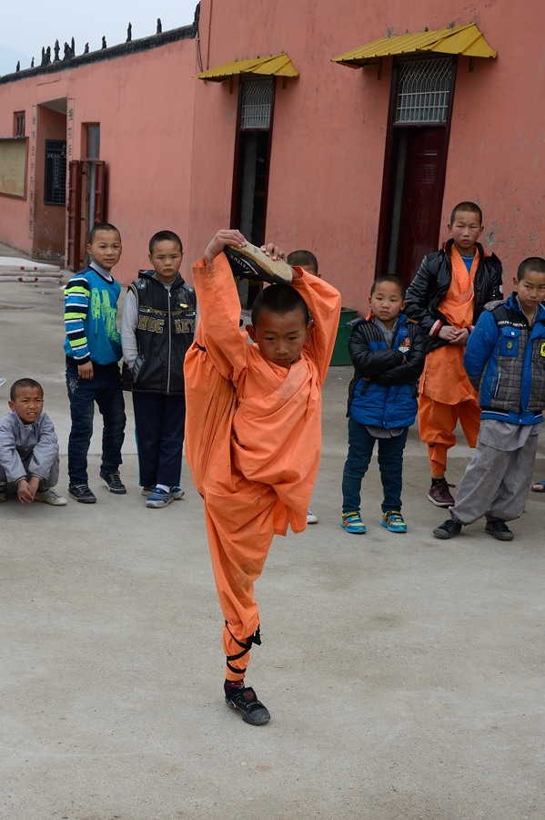 Kung Fu student demonstrating his flexibility