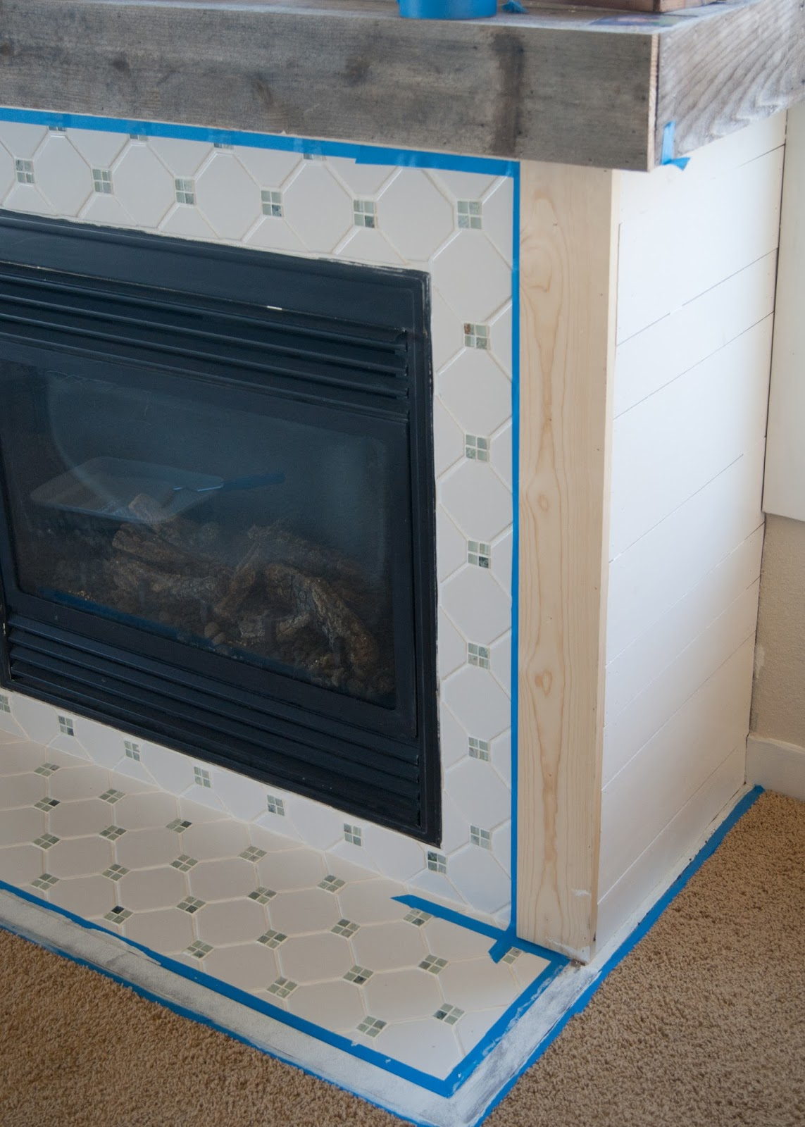 Fireplace Makeover - Grout, Paint & the best tool ever for caulking!
