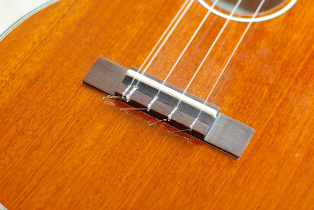 Ohana TK-35G-5 Tenor 5 string ukulele bridge