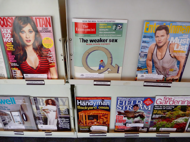 three magazines on library rack
