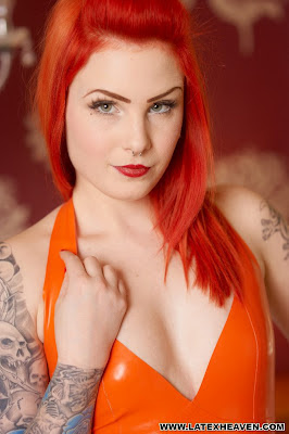 Sassy and Sexy Leanne in Orange Latex