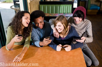 Young friends with cell phones