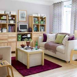 Pamba Boma Arranging Furniture in a Small Living Room