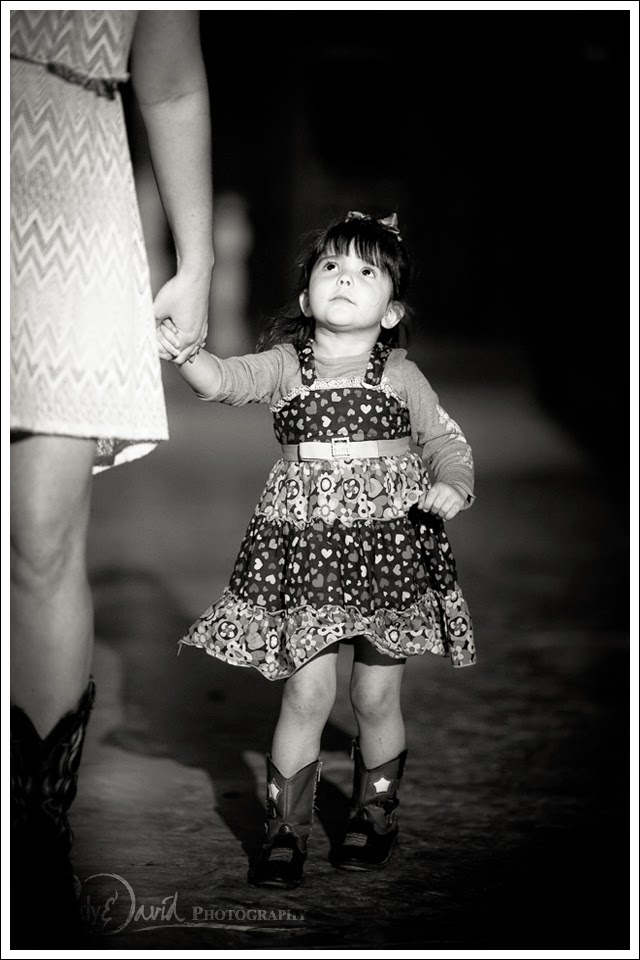 Little girl dances the night away in her cowboy boots