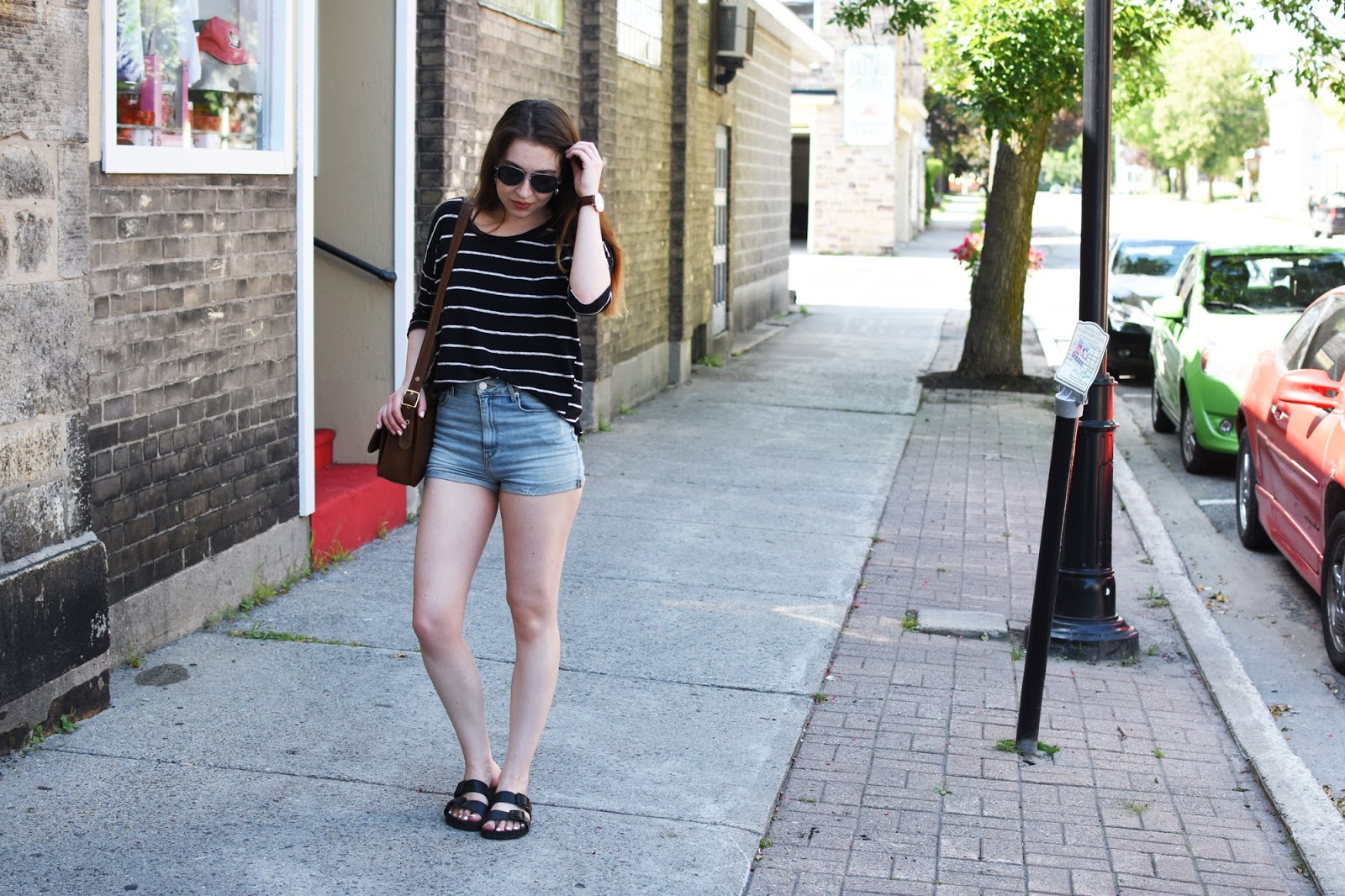 OOTD with Aritzia high waisted denim shorts, striped Zara top, vintage Coach bag, Warby Parker Crossfield glasses, and Daniel Wellington watch