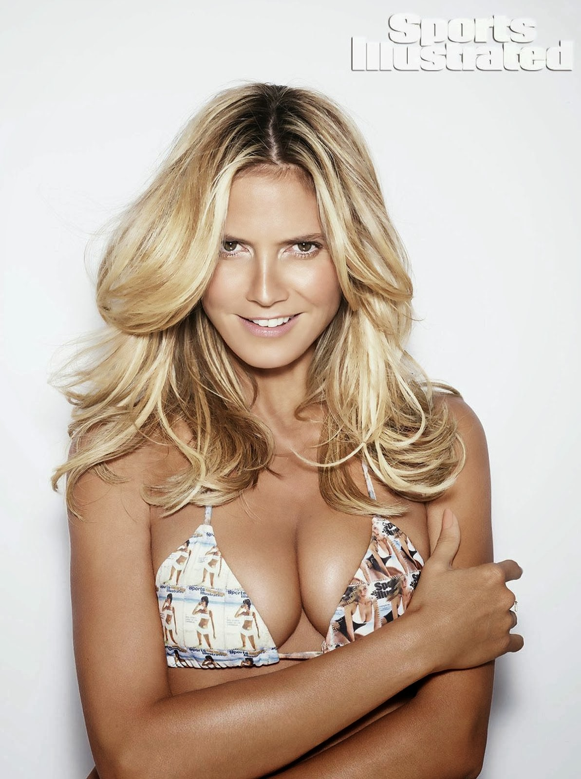 Heidi Klum puts a History in Sports Illustrated 2014 Swimsuit Issue