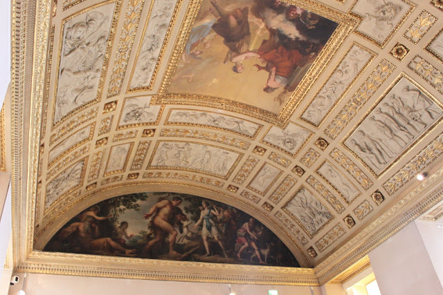 Ceiling art design with rich gold in colour in Lourve Museum in Paris, France
