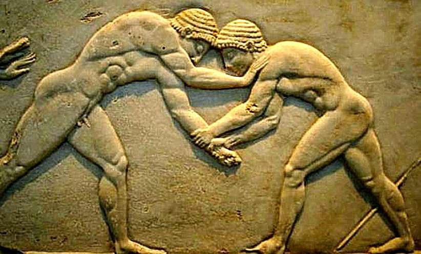 Luchadores de la Antigua Grecia compitiendo desnudos.