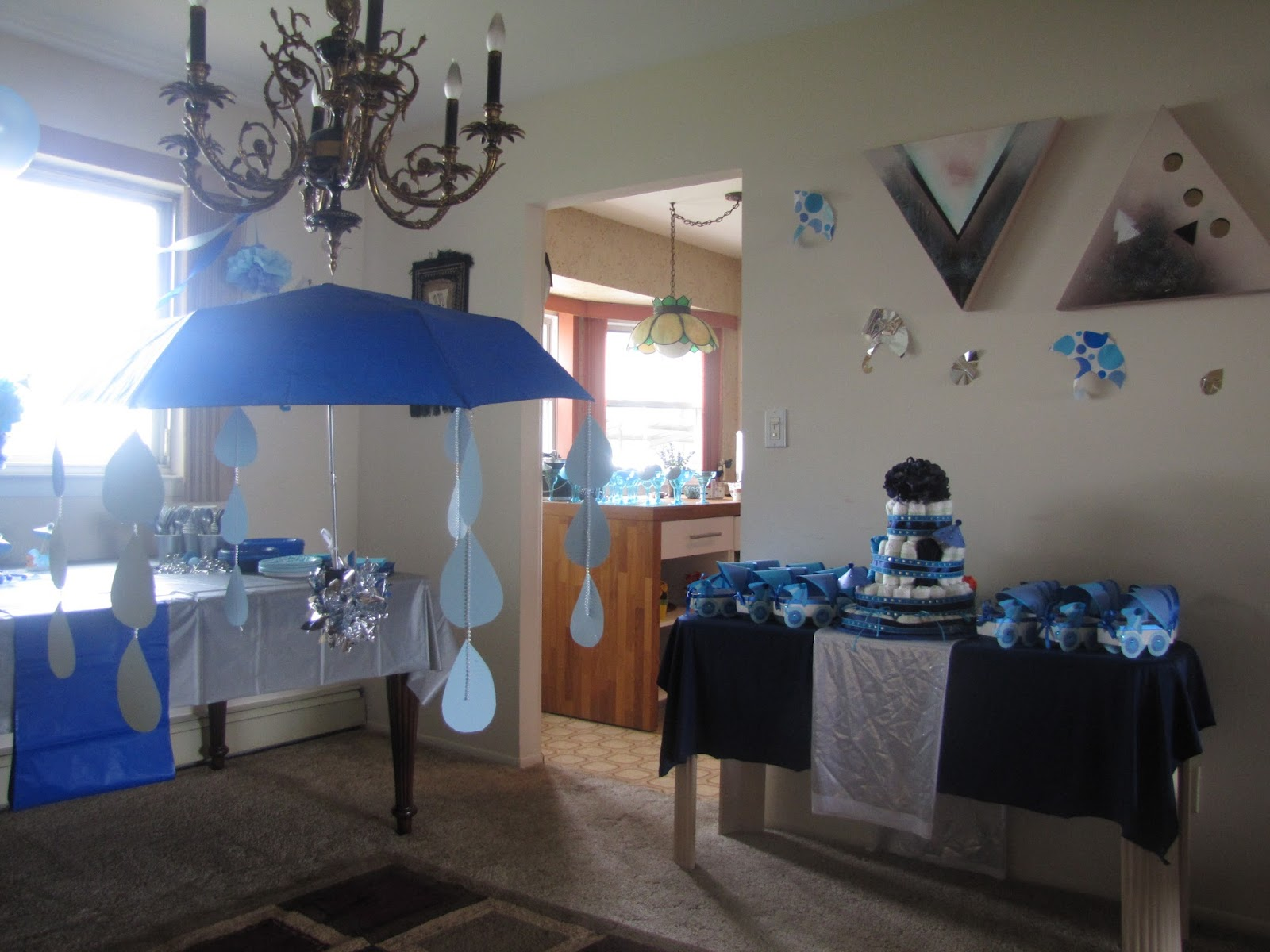 Mommy party planning april showers baby shower for Baby shower umbrella decoration ideas