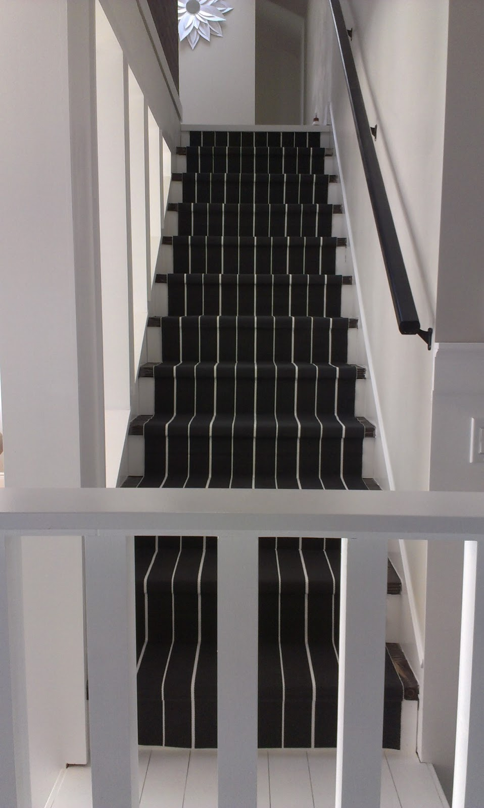 I Took This Photo While I Was Waiting For The Paint To Dry On The Trim  Piece. I Placed At The Bottom Of The Stairs To Cover The End Of The Stair  Runner.