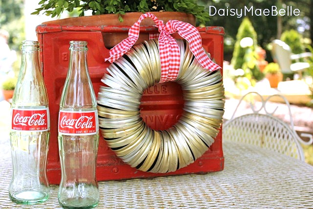 Make a 5 minute canning jar lid wreath by Daisy Mae Belle, featured on I Love That Junk