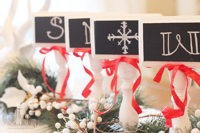Chalkboard signs made from candlesticks and wood blocks. Dipped in glitter to add a little shimmer!