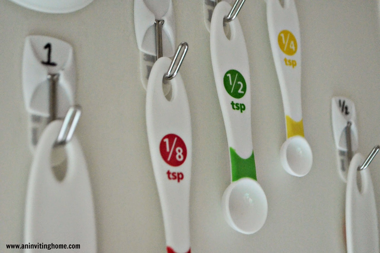 organizing measuring cups and spoons