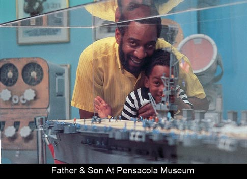 &lt;img src=&quot;image.gif&quot; alt=&quot;Father and Son Face at Pensacola Museum&quot; /&gt;