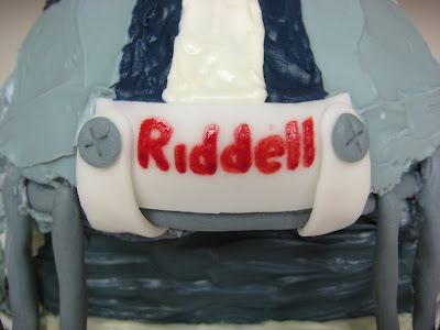 3D Dallas Cowboys Football Helmet Cake - Close-up of Riddell Nameplate