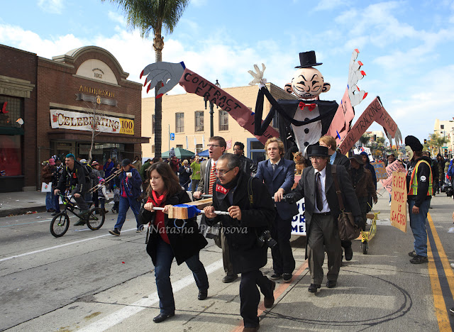 Monopoly Man, rose parade, occupy fights foreclosure, protest, float