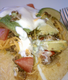Tacos with homemade seasoning, avocado, tomato, cheese and plain yogurt