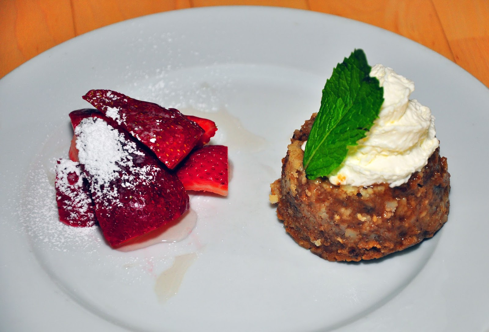 chestnut flan with strawberries in rum syrup and whipped cream