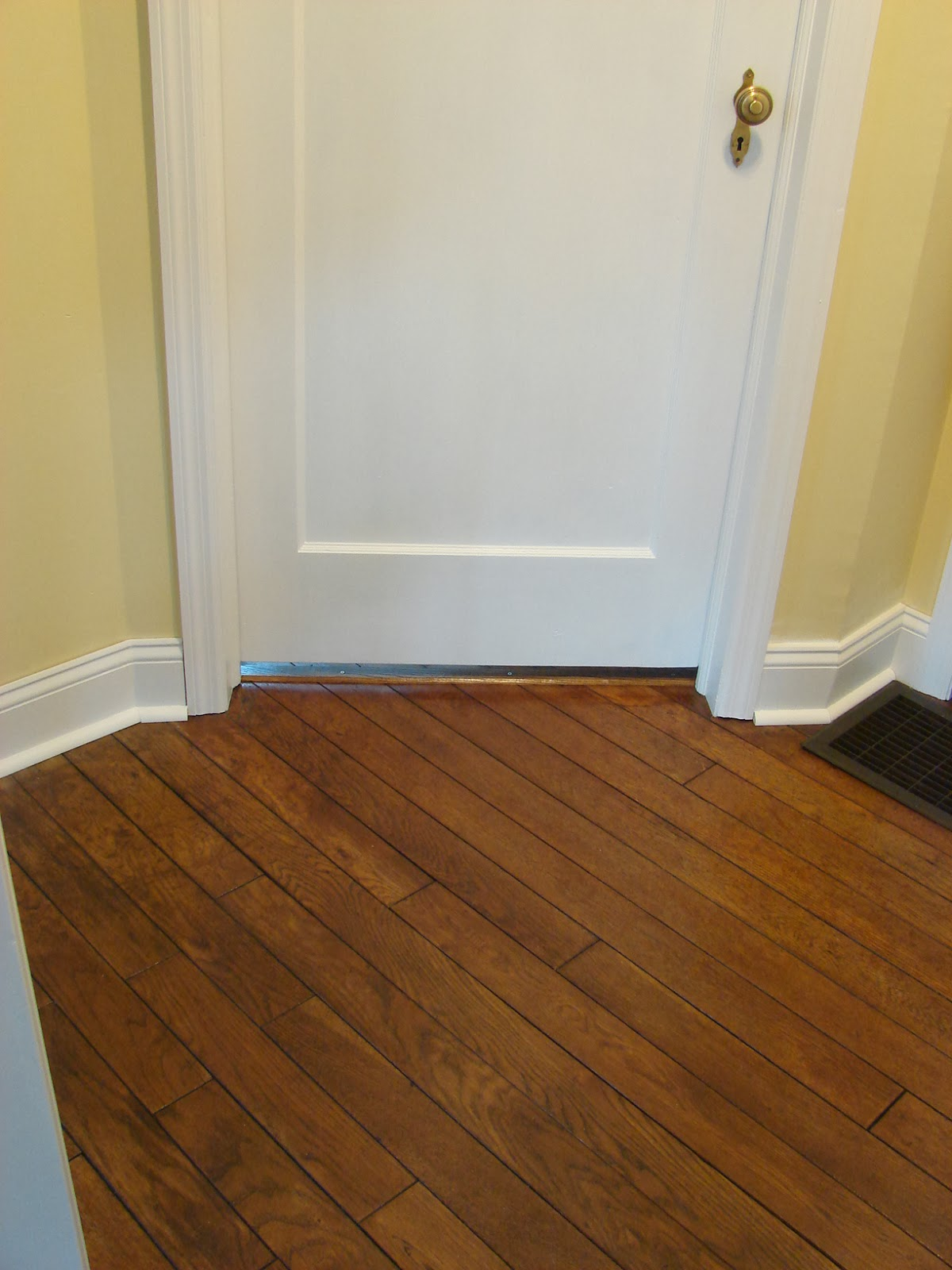 While I Was Refinishing The Doors And Replacing The Trim, I Also Refinished  The Wood Floor In This Area And Replaced The Floor Molding.