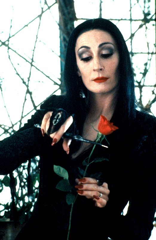 Anjelica Huston as Morticia Addams title=