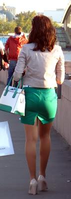Girl in tight green skirt on the street