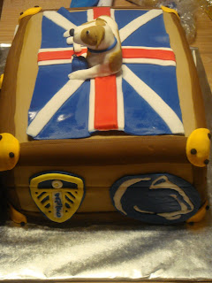 30th Birthday Suitcase Cake with Leeds United Football Club and Penn State sticker logos