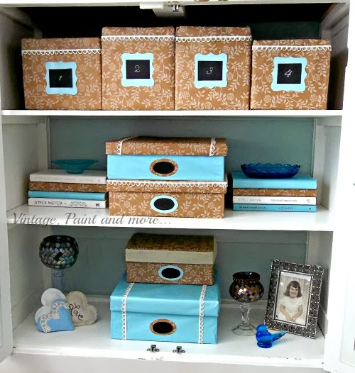 DIY Decorative Box Storage - view of inside of cabinet showing decorative boxes and vignettes