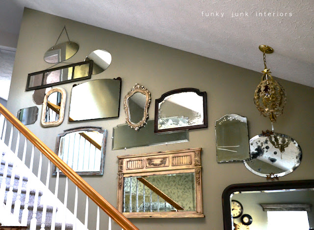A junk tour of Bella Rustica Linda's house via Funky Junk Interiors - mirror wall