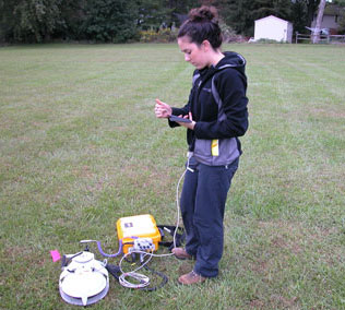 Co-author Erin Johnson collects data from a residential site. Credit: Photo courtesy of David Bowne.