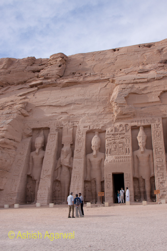 Tourists standing outside the smaller temple at Abu Simbel in south Egypt