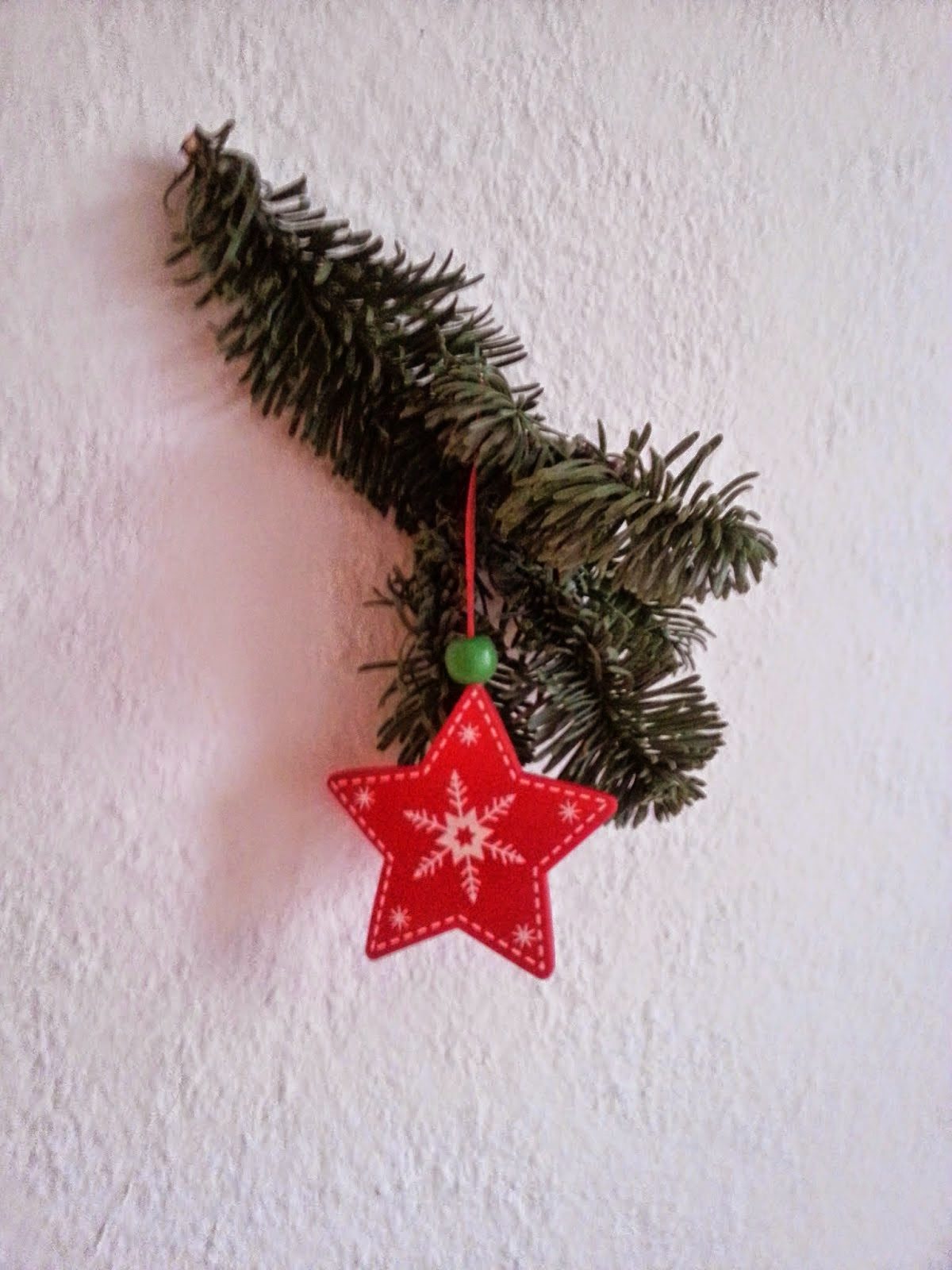 Christmas decoration - a branch of a Christmas tree and a star