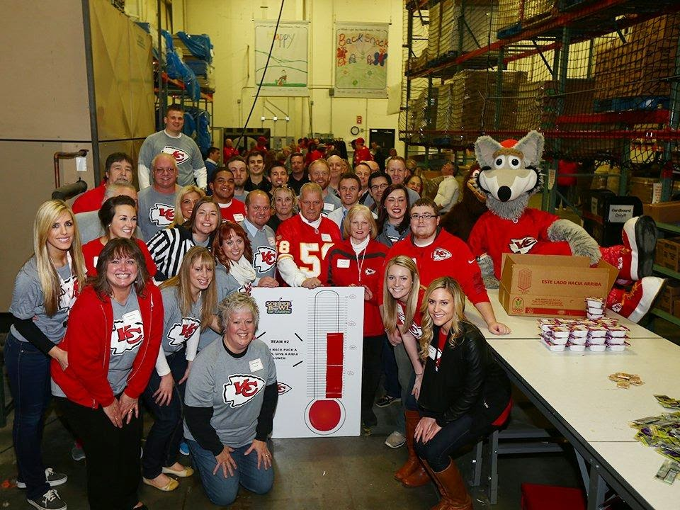 K.C. Chiefs staff posing at the Souper Bowl of Caring event