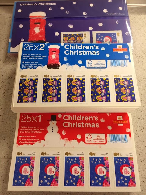 Presentation pack and folded stamp sheets for children's design christmas stamps.