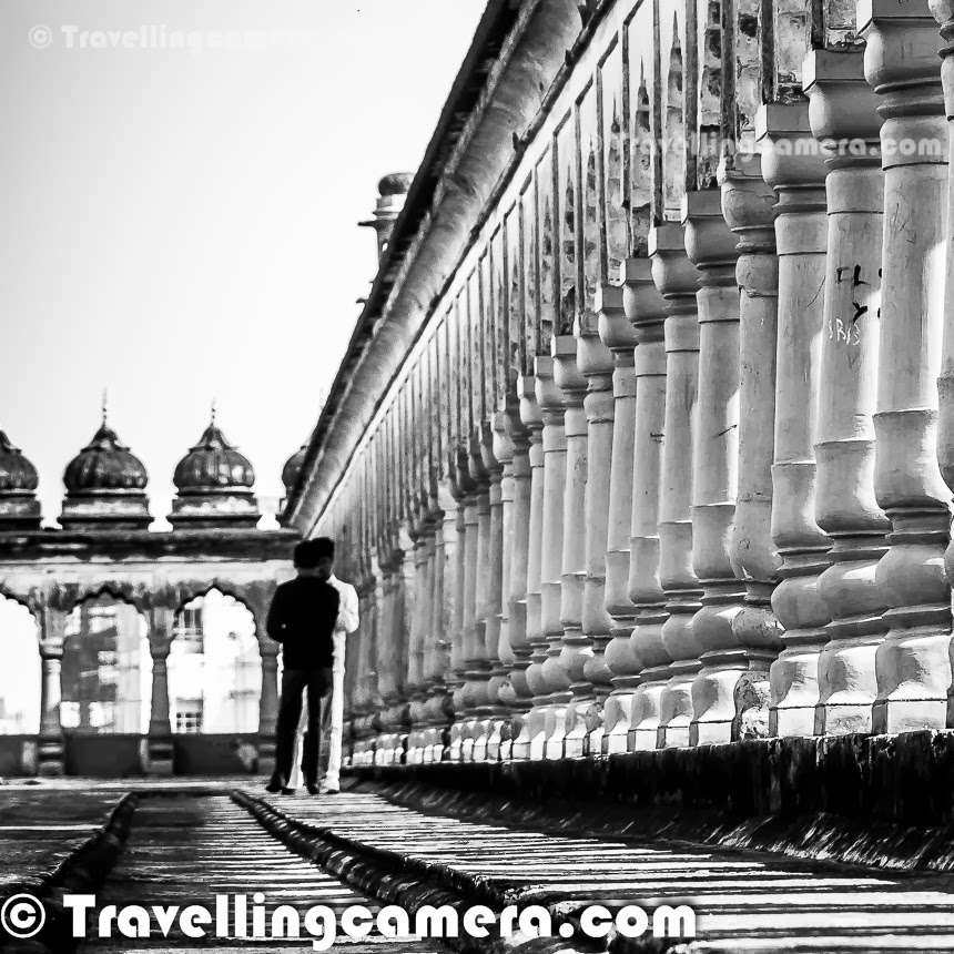 Some time back I shared about recent visit to Bada Imambara in Lucknow, which also has a maze which is popularly known as 'Bhool Bhulaiya'. This Photo Journey shares some interesting facts about Bhool Bhulaiya with appropriate photographs. Bhool Bhulaiya is probably one of best things to explore in Lucknow town and it's more fun to explore without any guide. At times guides can also add fun to this exploration process, because they also understand that people come to see a maze to have some interesting experience of getting lost. Above two photographs shows the way this maze is created. There are series of entry and exit points on both sides of this corridor. This one is one of the extreme corridors which was easy to click. Inside the maze, light was extremely low, so couldn't capture a good photographs inside the bhool bhulaiya. This photograph shows the roof-top of bhool bhuliyaa which offers some amazing views of the city on one side and Bada Imambara campus on the other. Many of the local folks in Lucknow highly recommend a visit to Bada Imambara. Lot of guides wait for tourists to serve them with a guided tour of bada Imambada and Bhool bhulaiya. Some of the guides are brilliant who take you through the tour in interesting way and ensure that you enjoy this exploration. At times, people suggest not to have a guide when going inside this maze called Bhool Bhulaiya. We also preferred not to have any guide at Bhool Bhulaiya. As we entered inside the maze, we were uncomfortable and not sure how much time it will take to come out. But it was fun to be lost and suddenly you start feeling that it's impossible to get out of this maze now. Now the trick is to follow any group which has a guide with them :) . We did the same and came out. There is a basic rule of coming out of this maze. If you want to know the trick, check out bottom of this post and if you want to have real fun, ignore it now and may come back when stuck inside. In my opinion, Bhool Bhulaiyaa is one of the best things to explore inside Bada Imambara complex. It's a must do thing in Lucknow to explore Bhool Bhulaiya and have fun with your friends & family.READ ONLY IF YOU HAVE NEVER WENT INSIDE THE MAZE - As promised, let us share the basic rule of coming out of Bhool Bhulaiya if you don't have guide with you and are stuck inside for a long time. Always take stairs going up and gradually they will lead to the roof-top. I am assuming that you are reading it while inside the maze and stuck, otherwise I will apologize to spoil the fun.