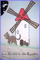 Gato y ratón delante de un molino