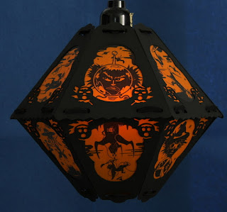 Outer space witch in spacesuit and rockets on retro kitsch Halloween lantern by Bindlegrim