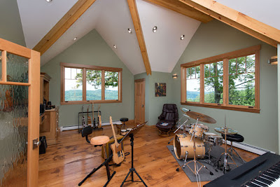 The home design includes a music room which shows off the homeowner's collection of instruments.