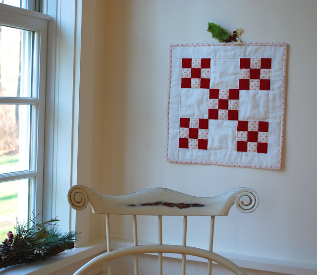 red and white doll quilt