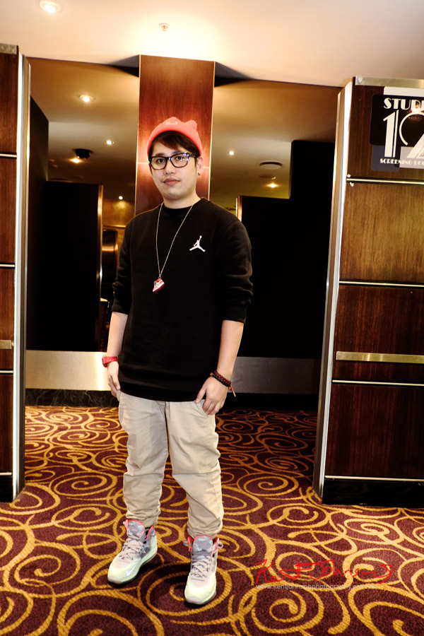 Ramon wears Air Jordan black jumper, beige chinos, red beanie and watch, hi-top basketball boots and necklace - The Way, Way Back preview night.