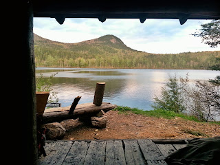 View from inside Swan Lake Trail shelter onto the mountains