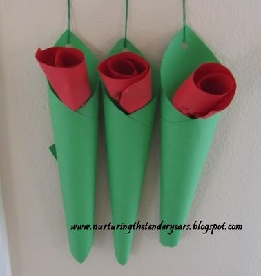 http://nurturingthetenderyears.blogspot.ca/2010/04/how-to-make-hanging-paper-roses-in-vase.html