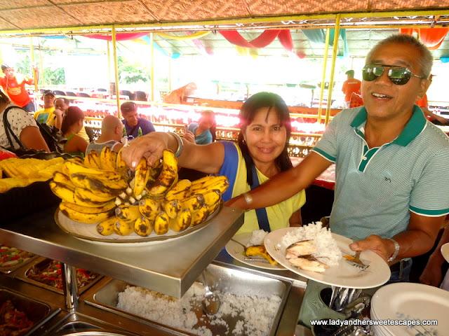 getting food while cruising at Loboc River Bohol