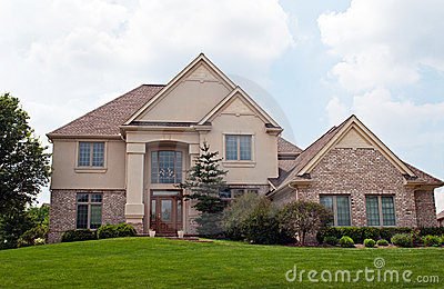 The thomas team blog may 2011 for Stucco and brick homes