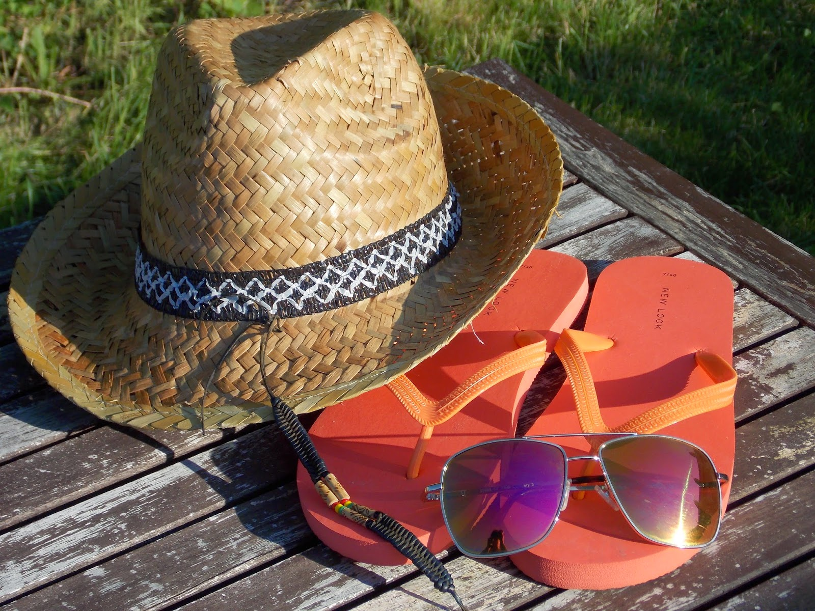 summer hat, flip flops, bracelet and sunglasses