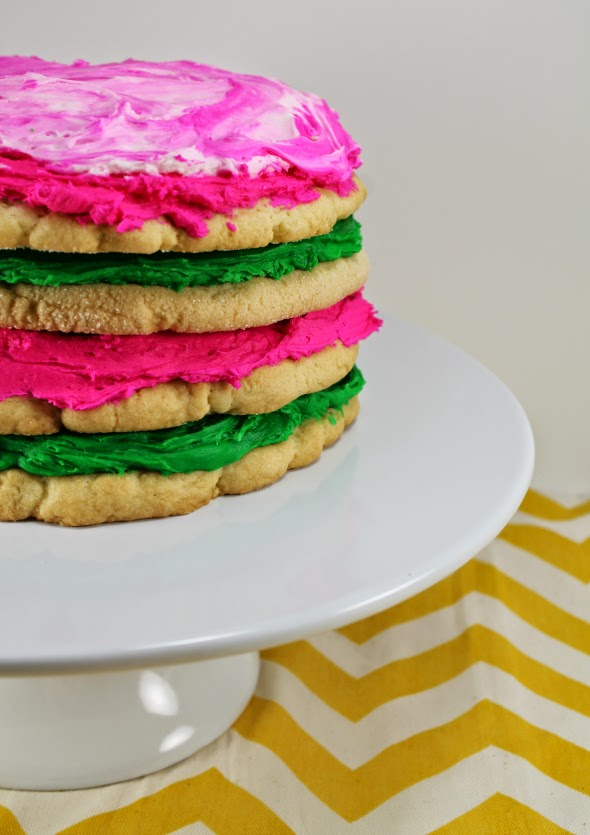 Giant Sugar Cookie Layer Cake - recipe makes 5 giant cookies, buy frosting from grocery story bakery for super cheap!